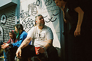 Ravers siting down talking, Chariot Spa, Fairchild St., Shoreditch, London May 2016.