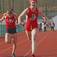 jamestown's Taylor Brightman crosses the finish line in the girls 100 meters at the Joseph Paterniti Memorial Track and Field Classic at Strider Field 5-13-16 photo by Mark L. Anderson