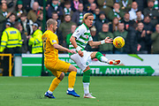 Mortiz Bauer (#13) of Celtic FC plays the ball past Scott Robinson (#17) of Livingston FC during the Ladbrokes Scottish Premiership match between Livingston FC and Celtic FC at The Tony Macaroni Arena, Livingston, Scotland on 6 October 2019.