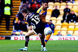 Malvind Benning of Mansfield Town gets the ball away from Max Wright of Grimsby Town - Mandatory by-line: Ryan Crockett/JMP - 04/01/2020 - FOOTBALL - One Call Stadium - Mansfield, England - Mansfield Town v Grimsby Town - Sky Bet League Two