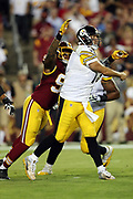 Pittsburgh Steelers quarterback Ben Roethlisberger (7) throws for a first down early in the second quarter despite defensive pressure from Washington Redskins linebacker Preston Smith (94) during the 2016 NFL week 1 regular season football game against the Washington Redskins on Monday, Sept. 12, 2016 in Landover, Md. The Steelers won the game 38-16. (©Paul Anthony Spinelli)