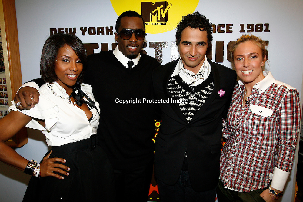"Stylist June Ambrose (L), performer and fashion designer Sean ""Diddy"" Combs, fashion designer Zac Posen (2nd R), and stylist Marni Senofonte (R) pose for photographers prior to an MTV contest to find an intern for Combs' Sean Jean fashion line in New York, February 19, 2008. REUTERS/Keith Bedford (UNITED STATES) ."