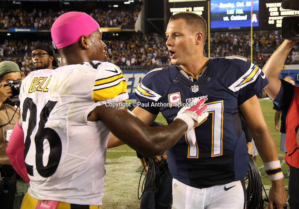 San Diego Chargers quarterback Philip Rivers (17) congratulates Pittsburgh Steelers running back Le'Veon Bell (26) after the 2015 NFL week 5 regular season football game against the San Diego Chargers on Monday, Oct. 12, 2015 in San Diego. The Steelers won the game 24-20. (©Paul Anthony Spinelli)
