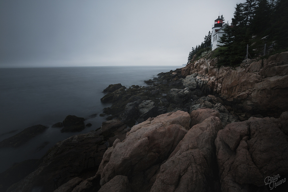 The Bass Harbor Head Light sits prominantly atop a rocky ledge of Mount Desert Island in Maine, waiting for Hurricane Arthur to make it's way along the coast.