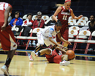 "Arkansas' Calli Berna (11), Arkansas' Dominique Robinson (21) and Ole Miss' Valencia McFarland (3) go for the ball at the C.M. ""Tad"" Smith Coliseum in Oxford, Miss. on Thursday, January 12, 2012."