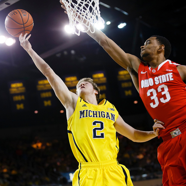 Feb 22, 2015; Ann Arbor, MI, USA; Michigan Wolverines guard Spike Albrecht (2) drives to the net is guarded by Ohio State Buckeyes forward Keita Bates-Diop (33) in the first half at Crisler Center. Mandatory Credit: Rick Osentoski-USA TODAY Sports