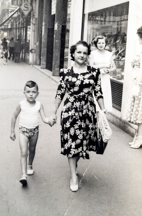 mother walking with son France ca 1960