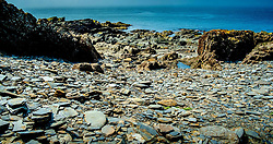 Easdale Island, the smallest permanently-inhabited island of the Inner Hebrides, Scotland.  Part of the slate covered coastline once the centre of the Scottish slate mining industry.<br /> <br /> (c) Andrew Wilson | Edinburgh Elite media