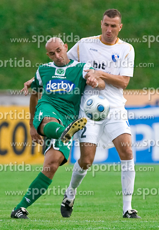 Senad Tiganj of Olimpija vs Dragoljub Nikolic of Gorica at football match between NK Olimpija vs Hit Gorica in 11th Round of Prva liga 2009 - 2010,  on September 27, 2009, in ZSD Ljubljana, Ljubljana, Slovenia.  (Photo by Vid Ponikvar / Sportida)