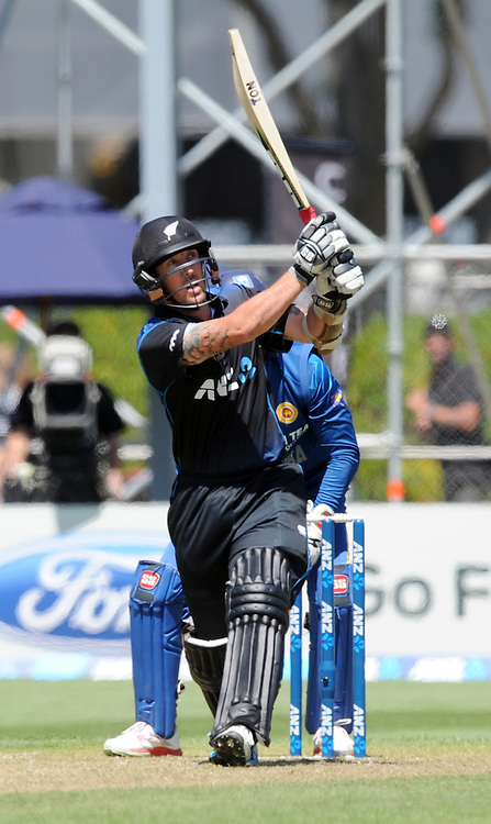New Zealand's Luke Ronchi scores a six into the grandstand against Sri Lanka in the 5th One Day International cricket match at University Oval, Dunedin, New Zealand, Friday, January 23, 2015. Credit:SNPA / Ross Setford
