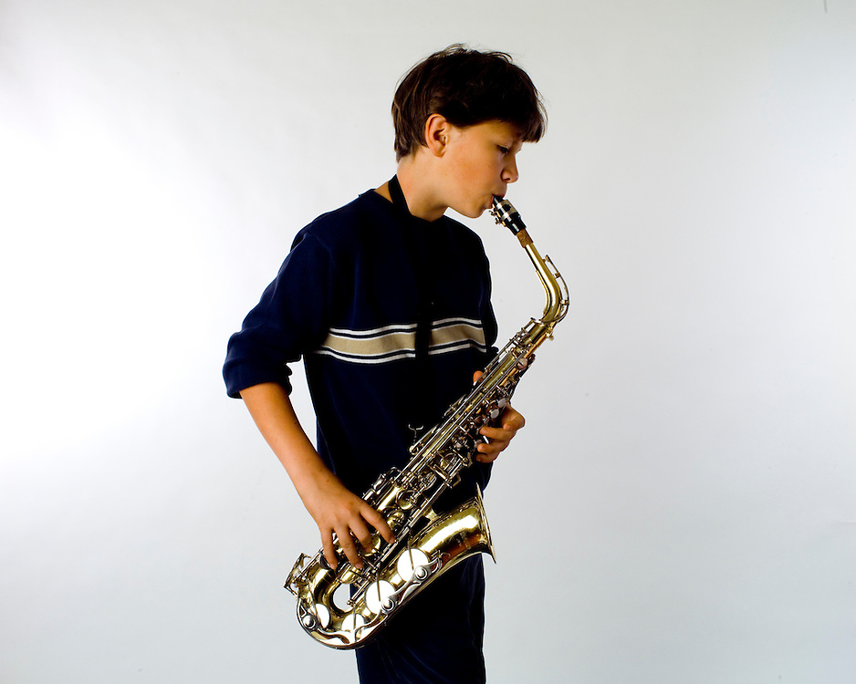 Sound energy, boy playing saxaphone