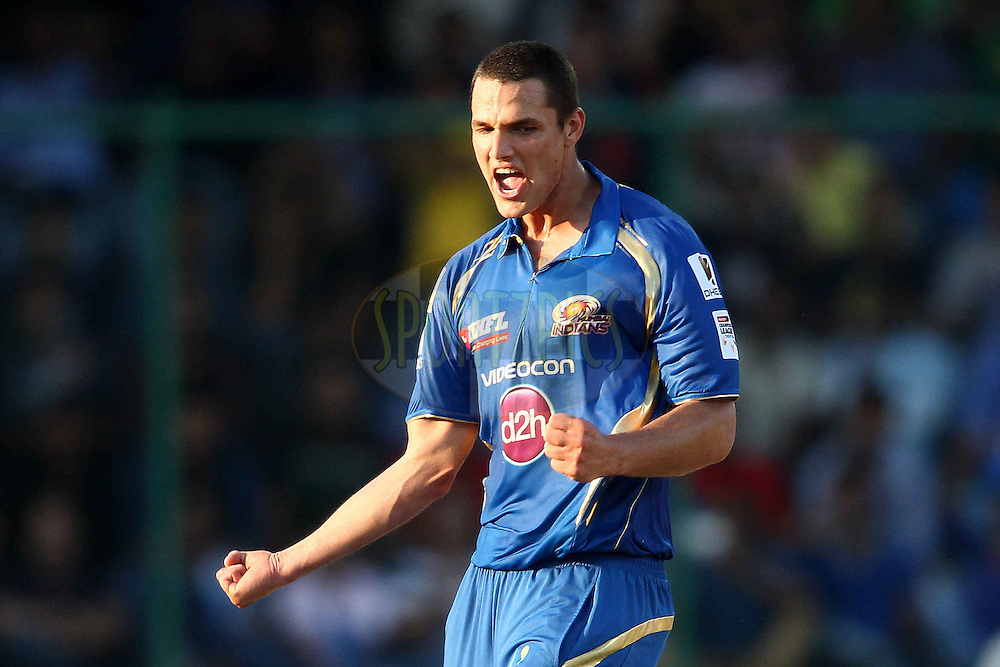 Nathan Coulter-Nile of Mumbai Indians celebrates trapping Ashton Turner of Perth Scorchers LBW during match 19 of the Karbonn Smart Champions League T20 between the Perth Scorchers and the Mumbai Indians held at the Feroz Shah Kotla Stadium, Delhi on the 2nd October 2013<br /> <br /> <br /> Photo by Shaun Roy-CLT20-SPORTZPICS <br /> <br /> Use of this image is subject to the terms and conditions as outlined by the CLT20. These terms can be found by following this link:<br /> <br /> http://sportzpics.photoshelter.com/image/I0000NmDchxxGVv4