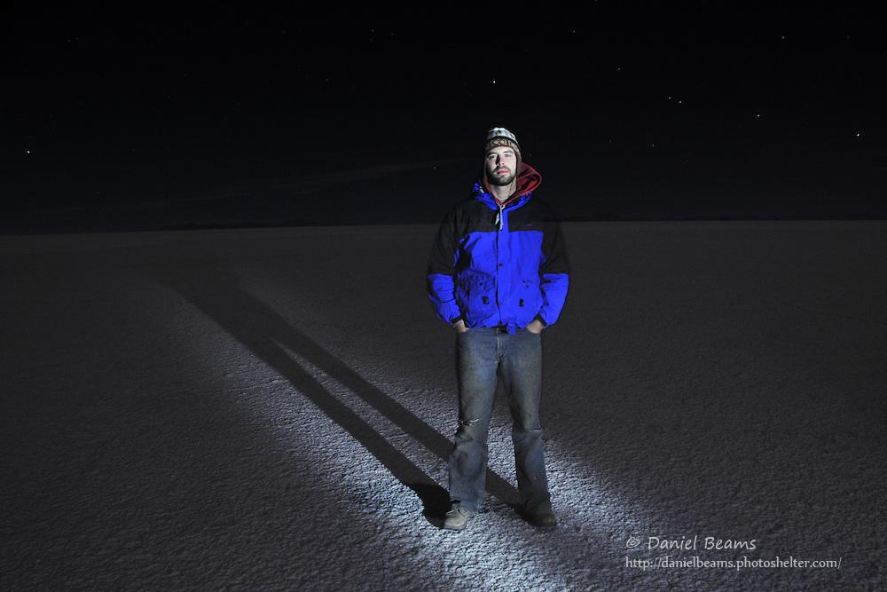 Ghost image of tourist on the Salar de Uyuni, Bolivia at night