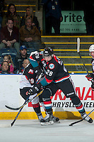 KELOWNA, CANADA - NOVEMBER 15: Shane Collins #19 of the Prince George Cougars is checked by Nolan Foote #29 of the Kelowna Rockets during second period on November 15, 2016 at Prospera Place in Kelowna, British Columbia, Canada.  (Photo by Marissa Baecker/Shoot the Breeze)  *** Local Caption ***