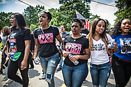 Saraland Alabama, May 20, 2018,<br /> Chikesia Clemons in the middle of supporters in Saraland Alabama during a  march seeking justice for her in Saraland, AL .Next to Clemons on ther right  is Tamika D. Mallory, one of the leaders of the Women's March. Next to her is Yandy Smith. To Clemons left is Campaign Zero co-founder Brittany Packnett and Ernestine Johnson
