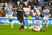 George Evans of Derby County (17) and Aaron Mooy of Huddersfield Town (10) during the EFL Sky Bet Championship match between Huddersfield Town and Derby County at the John Smiths Stadium, Huddersfield, England on 5 August 2019.