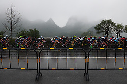 The peloton begin in damp conditions at GREE Tour of Guangxi Women's World Tour 2018, a 145.8 km road race in Guilin, China on October 21, 2018. Photo by Sean Robinson/velofocus.com
