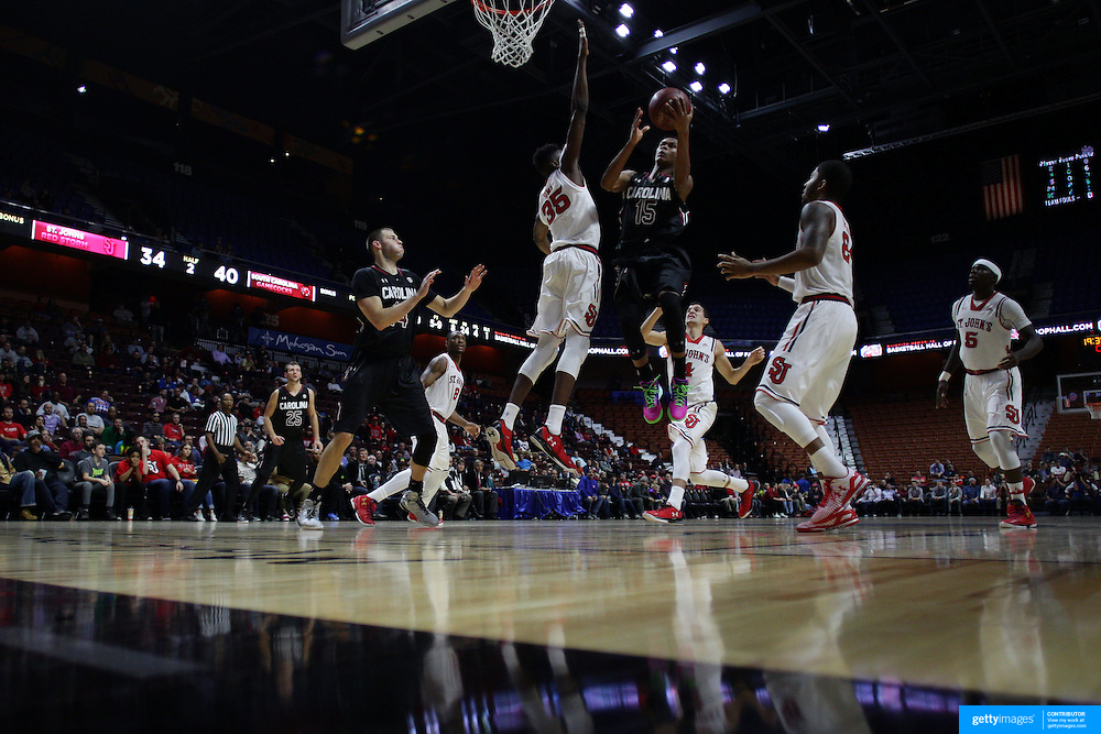 PJ Dozier, South Carolina, drives to the basket  during the St. John's vs South Carolina Men's College Basketball game in the Hall of Fame Shootout Tournament at Mohegan Sun Arena, Uncasville, Connecticut, USA. 22nd December 2015. Photo Tim Clayton