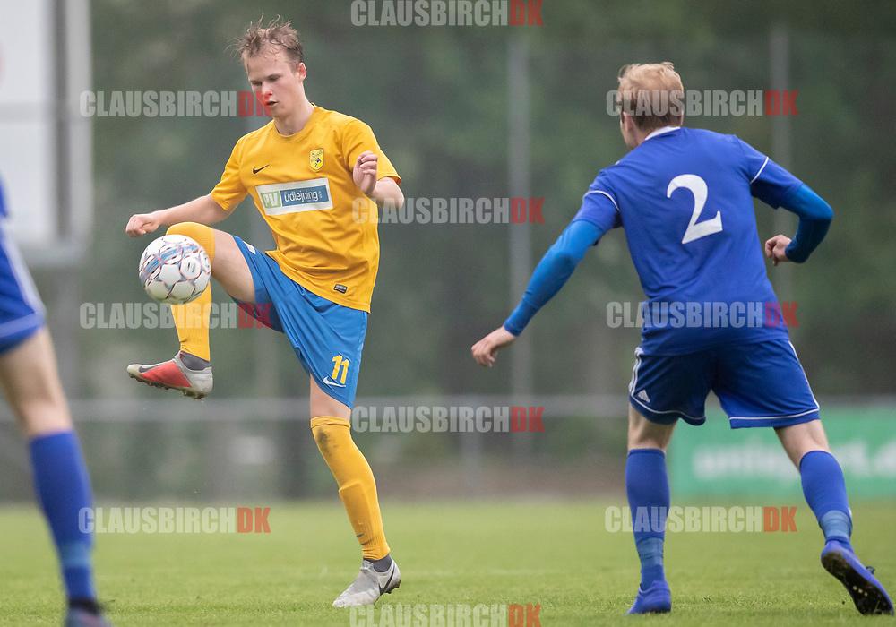 FODBOLD: Magnus Strøm (Ølstykke FC) under kampen i DBU Pokalens Indledende runde mellem Ølstykke FC og Lundtofte Boldklub den 21. maj 2019 på Ølstykke Stadion. Foto: Claus Birch