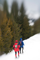 North America, United States, Washington, Crystal Mountain, man and woman snowshoeing