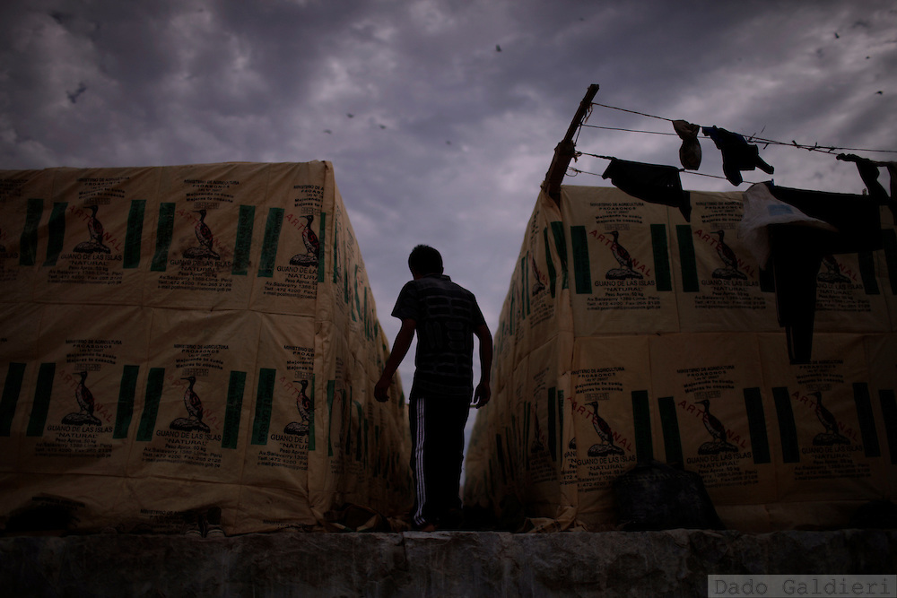 A miner enters the temporary shelters used as tents at a camp in Ballestas Islands, in the southern shores of  Peru, October 8, 2011. Along the dry and magnificent Peruvian Pacific coast, 22 scattered islands are home to millions of migratory birds such as guanays, boobies and pelicans..Nesting in these  island for millennia their excreta has been used by ancient civilizations to fertilize Andean crops and sustain evolved societies. Now, being one of the finest organic fertilizers in the world they move an economy of around 10 billion dollars, considering the average price of 500 USD a ton, according to  Rural Agrarian Productive Development Program (Agrorural) .The bird dung, also known as guano, reached its greatest economic importance in the 19th century as a coveted resource being exported to the United States, England and France..But now  the country, being led by a leftist president, hopes to benefit mostly small farmers by boosting organic agriculture through these natural fertilizers.. (Photo Dado Galdieri)