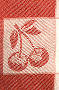 close up of woven fabric with cherry design
