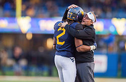 Oct 22, 2016; Morgantown, WV, USA;  West Virginia Mountaineers wide receiver Ka'Raun White (2) celebrates with West Virginia Mountaineers head coach Dana Holgorsen after catching a touchdown during the third quarter against the TCU Horned Frogs at Milan Puskar Stadium. Mandatory Credit: Ben Queen-USA TODAY Sports