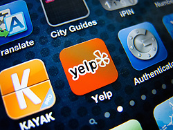 detail of iPhone 4G screen showing Yelp customer review  app