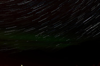 Night Sky, Star Trails, and Northern Lights looking northeast from Haines, Alaska. Composite of images from 03:30 to 03:59 taken with a Nikon D3x camera and 45 mm f/2.8 PC-E lens (ISO 400, 45 mm, f/5.6, 29 sec). Raw images processed with Capture One Pro and the composite generated using Photoshop CC (statistics, maximum).