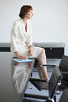 Business woman sitting on conference table