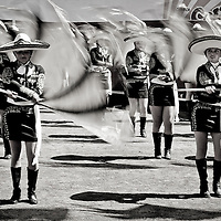 """Mariachi"" girls performance a show, during the inauguration parade, of one of the Oldest Bullfighting carnival in Latin America.  Every year since 1831 this small town at the south west of Mexico celebrates a festivities before  the beginning of the Easter."
