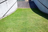 Grass verge between two brick walls