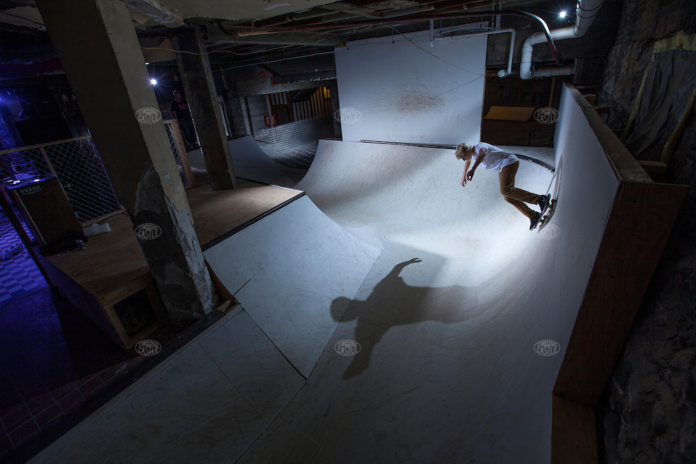 photograph ©2014 tom wagner<br /> sitelab at Morton, skate:lab, a collaborative installation between site lab and premier skate shop of grand rapids, to create a indoor skatepark in the basement of the building making use of live skaters and video projections of a skate session from the bldg forartprize 2014. morton hotel. grand rapids, Mi