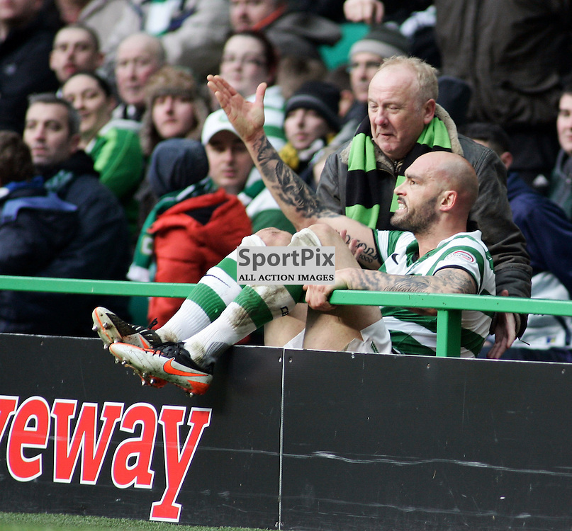 An angry daniel majstorovik celtic ends up in the crowd after a heavy challenge with Claude Gnakpa inverness in the clydesdale bank premier league game at celtic park picture kevin mcglynn