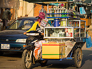 27 FEBRUARY 2015 - PHNOM PENH, CAMBODIA: A soft drink vendor in her motorcycle driven soft drink stand in Phnom Penh.   PHOTO BY JACK KURTZ