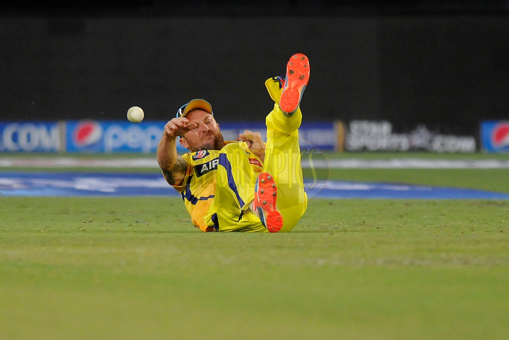 Brendon McCullum of The Chennai Superkings dives to stop a ball during match 13 of the Pepsi Indian Premier League Season 7 between the Chennai Superkings and the Mumbai indians held at the Dubai International Stadium, Dubai, United Arab Emirates on the 25th April 2014<br /> <br /> Photo by Pal Pillai / IPL / SPORTZPICS