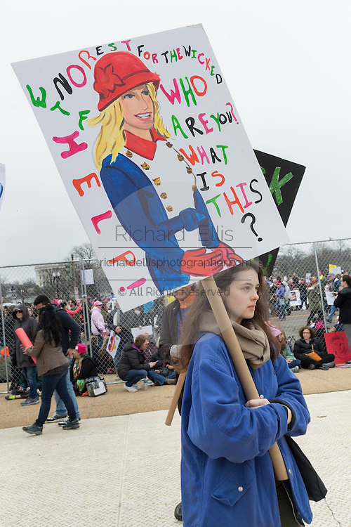 A demonstrator carries a sign directed at Kellyanne Conway during the Women's March on Washington in protest to President Donald Trump January 21, 2017 in Washington, DC. More than 500,000 people crammed the National Mall in a peaceful and festival rally in a rebuke of the new president.
