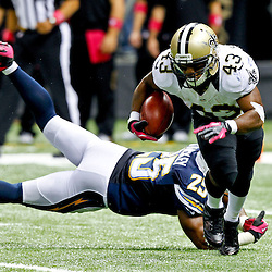 October 7, 2012; New Orleans, LA, USA; New Orleans Saints running back Darren Sproles (43) runs from San Diego Chargers defensive back Darrell Stuckey (25) during the fourth quarter of a game at the Mercedes-Benz Superdome. The Saints defeated the Chargers 31-24. Mandatory Credit: Derick E. Hingle-US PRESSWIRE