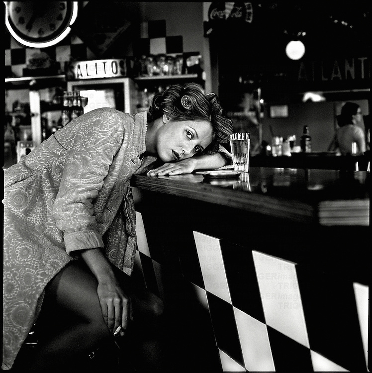 A young woman sitting at a bar