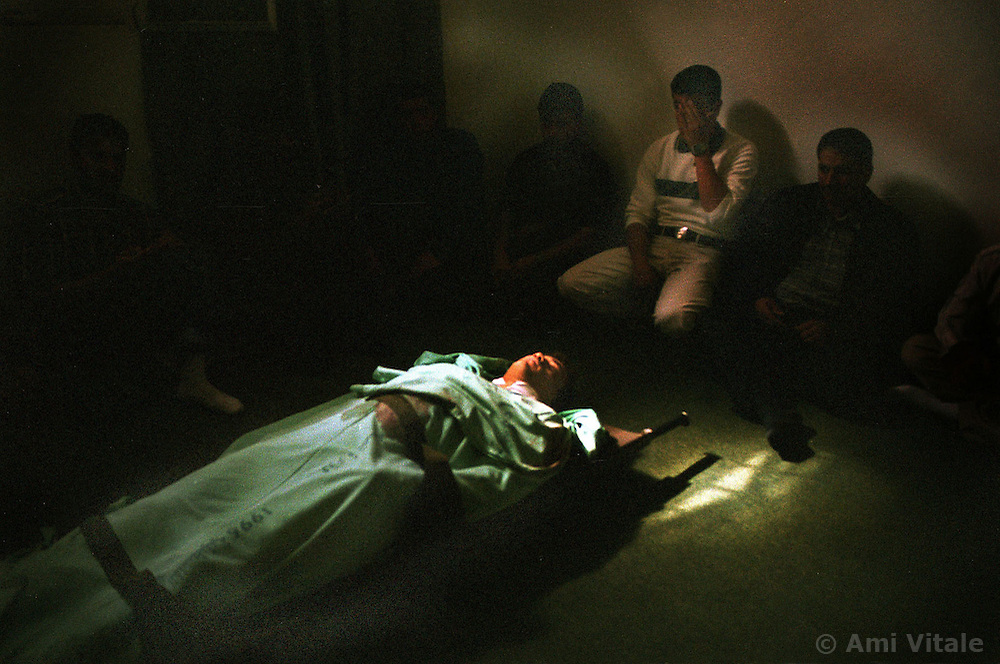 The family of Mnsor Tahasied Ahmed, 22, mourns his death before he is buried in Hebron, Saturday, October 14, 2000.  He was killed on Friday by Israeli soldiers. (Photo by Ami Vitale)
