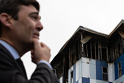 "© Licensed to London News Pictures. 16/11/2019. Bolton, UK. ANDY BURNHAM , mayor of Manchester , at the site of the blaze . Firefighters work at the scene where a fire broke out overnight (15th/16th November 2019) at a block of flats known as "" The Cube "" , in Bolton Town Centre . At least two people are known to have been treated by paramedics at the scene of the six-story block , which is occupied by students of the University of Bolton . Photo credit: Joel Goodman/LNP"