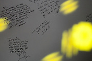 Handwritten messages on a memorial at a benefit concert for the Yellow Dogs, the band whose members were killed last week, at Brooklyn Bowl, 61 Wythe Avenue in the Williamsburg neighborhood of Brooklyn, NY on Monday, Nov. 18, 2013.<br /> <br /> Photograph by Andrew Hinderaker