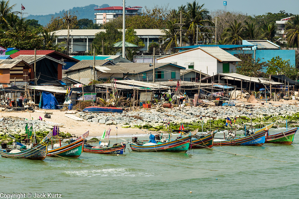 07 FEBRUARY 2014 - KAO SENG, SONGKHLA, THAILAND:  The Muslim fishing port of Kao Seng. Kao Seng is a traditional Muslim fishing village on the Gulf of Siam near the town of Songkhla, in the province of Songkhla. In general, their boats go about 4AM and come back in about 9AM. Sometimes the small boats are kept in port because of heavy seas or bad storms.     PHOTO BY JACK KURTZ