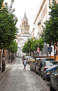 Traditional housing area in city centre,  Barrio Macarena, Seville, Spain looking to Iglesia de San Marcos church
