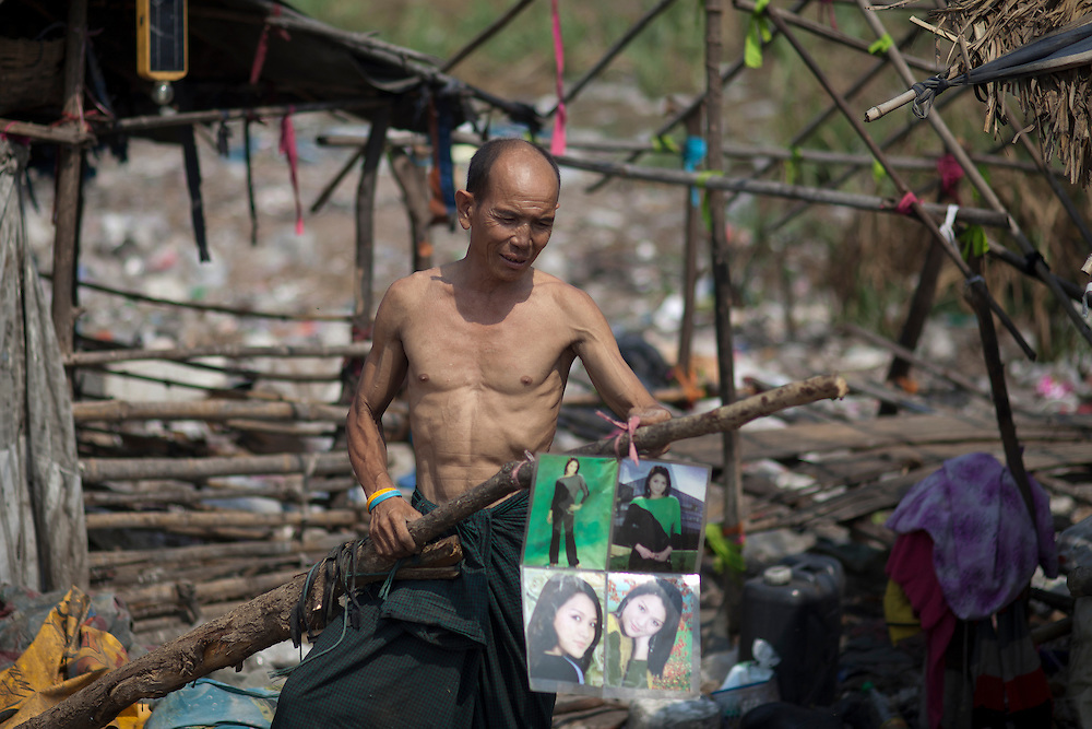 A refugee from Myanmar are seen in front of his house on rubbish dump in Mae Sot on Friday, 23, 2012. With April 1 elections coming soon Myanmar has suffered conflict between the repressive ruling military regime, political opponents and ethnic groups, resulting in the displacement of over 400.000 Burmese according to UNHCR, around 140.000 of them in Thailand.