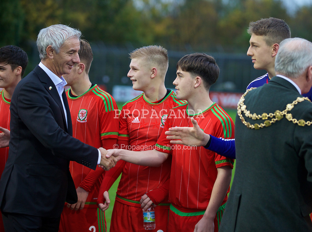 NEWPORT, WALES - Thursday, November 5, 2015: Wales' Elite Performance Director Ian Rush shakes hands with Wales players after the Under-16's Victory Shield International tournament at Dragon Park. (Pic by David Rawcliffe/Propaganda)