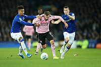 Football - 2019 / 2020 EFL Carabao (League) Cup - Quarter-Final: Everton vs. Leicester City<br /> <br /> Marc Albrighton of Leicester City  tackled by Mason Holgate and Seamus Coleman of Everton at Goodison Park.<br /> <br /> COLORSPORT/LYNNE CAMERON