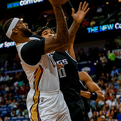 Mar 31, 2017; New Orleans, LA, USA; New Orleans Pelicans forward DeMarcus Cousins (0) shoots over Sacramento Kings center Willie Cauley-Stein (00) during the first quarter of a game at the Smoothie King Center. Mandatory Credit: Derick E. Hingle-USA TODAY Sports