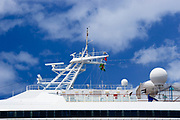 Radar and satellite communications mast on Carnival Destiny cruise ship docked in Roseau, Dominica