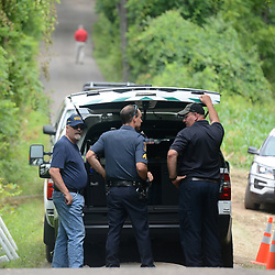 July 13, 2017 - Solebury Township, Bucks County, Pennsylvania, U.S. - Police and other crews work at the crime scene off of Lower York Road during day five in the search for missing Bucks County men on Thursday. A Pennsylvania man under suspicion for his connection to the disappearance of four men who disappeared in rural Pennsylvania last weekend has confessed to their murders. (Credit Image: © Chris Shipley/TNS via ZUMA Wire)